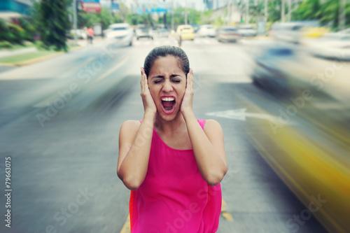 Portrait business woman screaming at street car traffic - 79663075