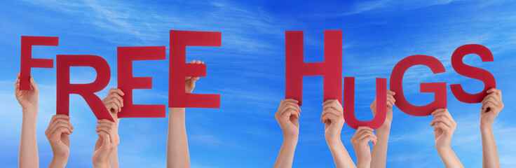 People Hands Holding Red Word Free Hugs Blue Sky