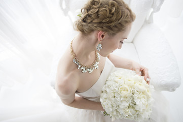 Bride sitting with a bridal bouquet