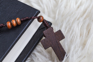 Christian cross necklace on Holy Bible book, Jesus religion conc