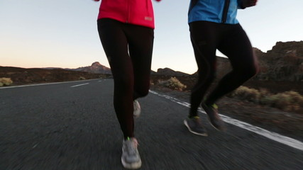 Fitness people running - runners on mountain road
