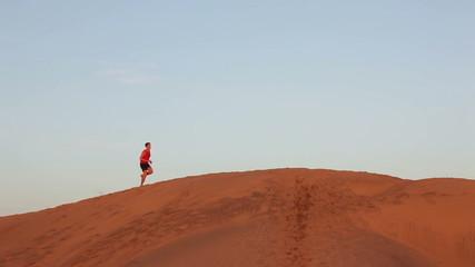 Running man - Jogging athlete runner in desert