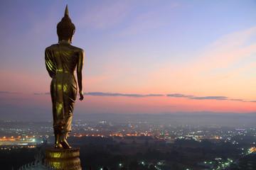 behind Buddha statue before sunrise time