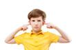 a teenage boy plugs ears
