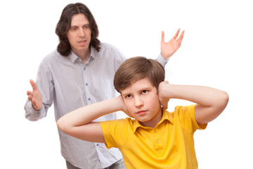 man shouting at a small boy who is not listening