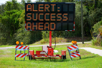 Alert: Success Ahead Lighted Road Sign