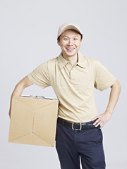 studio portrait of a smiling delivery man