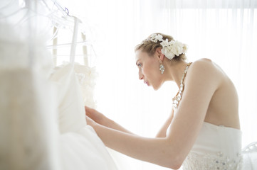 Bride is choosing a wedding dress