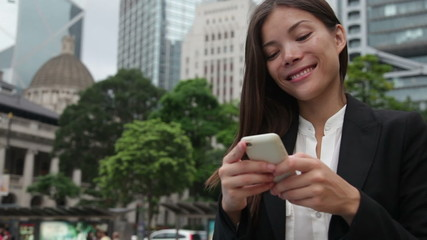 Asian businesswoman on smartphone in Hong Kong