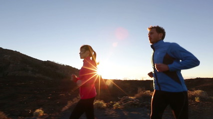 Sport runners running exercising outdoors on road