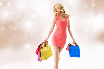 Attractive youg woman doing the shopping