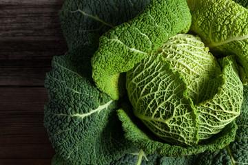 Savoy cabbage superfood closeup on dark wooden backround