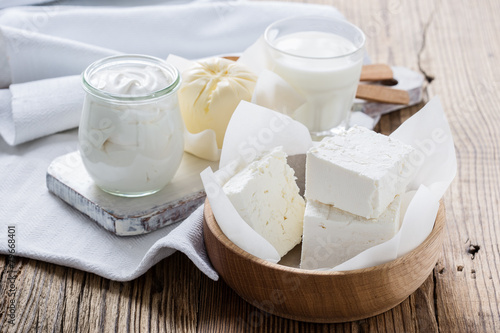 Dairy products on wooden table - 79668401