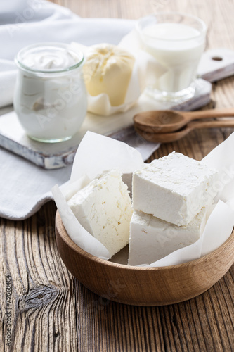 Dairy products on wooden table - 79668404