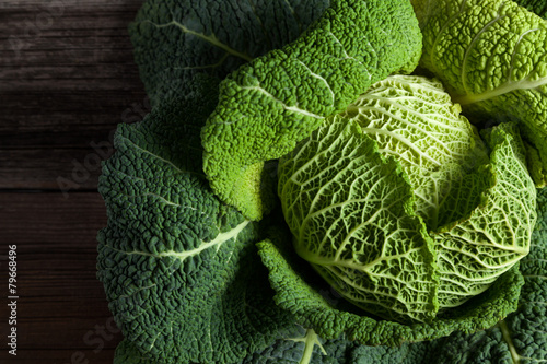 Savoy cabbage superfood closeup on dark wooden backround - 79668496