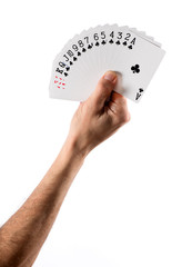 Hand Holding Fanned Cards Showing Club Suit