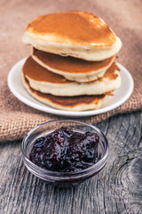 homemade pancakes with currant jam. Selective focus
