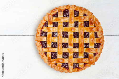 Fototapeta Raspberry pie with fresh raspberries on white background