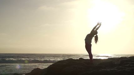 Slow Motion Woman Practicing Yoga Stretching Pose At Sunset
