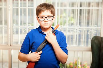 Nerdy kid with a toy gun