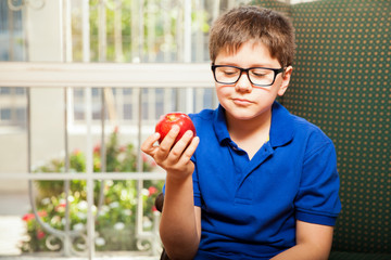 Kid about to eat an apple