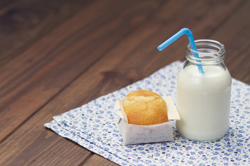A magdalena (Spanish muffin) and school milk bottle