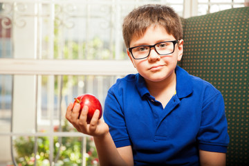 Boy holding an apple in his hand