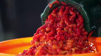 hand grinding paprika clouseup