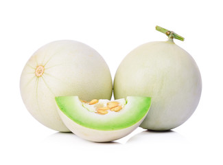 Honeydew melon sliced in half isolated on white