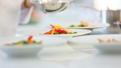 Closeup of meal preparation in restaurant kitchen
