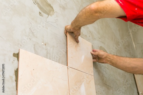 Hands and tiles Poster