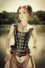 Beautiful steampunk redhair woman with body art on her face outd