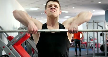 Sports man hard training in gym