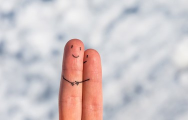 Happy fingers on a snow background