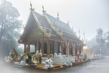 Foggy Buddhist Temple at the top of a misty mountain.