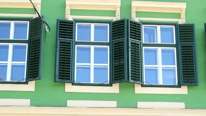 Green Windows with Shutters