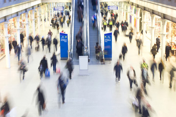 London Train Tube station Blur people movement in rush hour, at