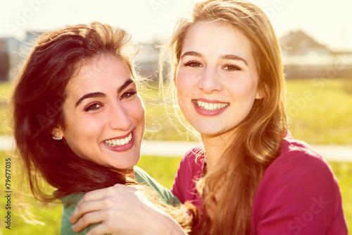 Two happy girls - 79677035