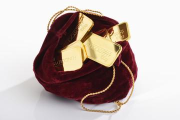 Goldbarren mit Samt Säckchen