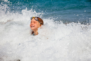 Child playing in the sea