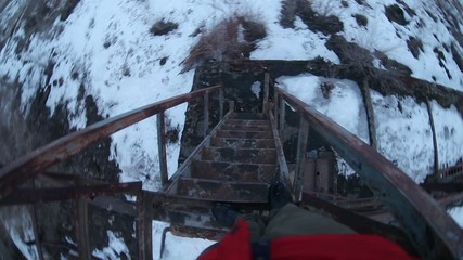 man stands on a ladder old abandoned train first-person video