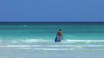 LUCAYAN BEACH/GRAND BAHAMA MARCH 2011: Man in sea at beach
