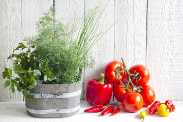 Fresh herbs and spices on white planks food concept