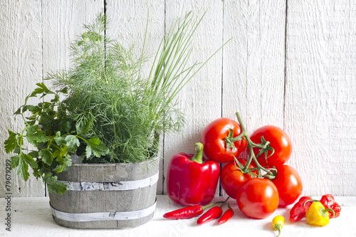 Fotobehang Kruiderij Fresh herbs and spices on white planks food concept