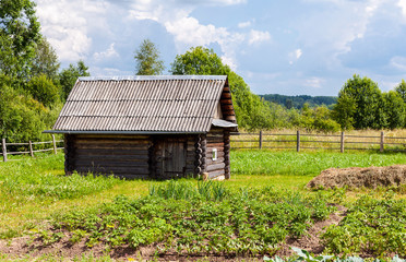 Traditional russian wooden bath in summer day