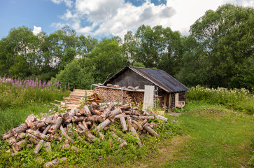 Traditional russian old wooden bath in summer day
