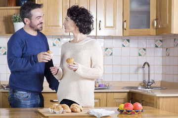 Man and woman eating homemade cupcakes