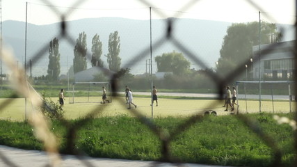 Playing Football in Neighborhood