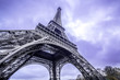 Leinwanddruck Bild - Eiffel Tower scenic bottom view. Purple sky