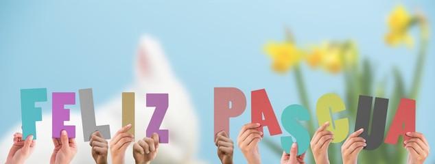 Composite image of hands holding up feliz pasqua